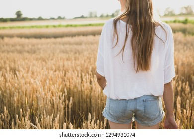 Woman in yellow wheat