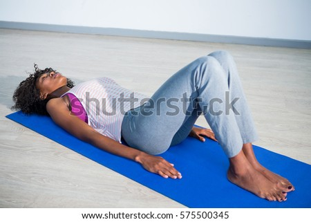 woman yoga corpse pose gym stock photo edit now 575500345