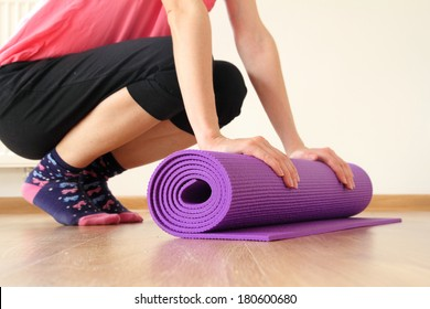 woman with yoga mat