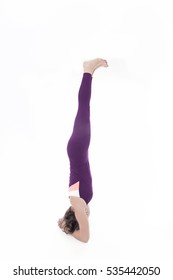 woman in yoga pose headstand sirsana isolated