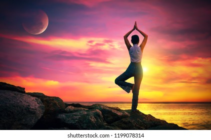 Woman in Yoga Pose on the Beach at Sunset. relax in nature