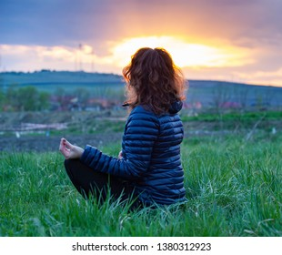 woman in a yoga pose at sunset - mindfulness, meditation, mental health