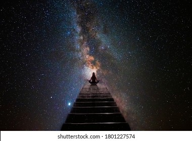 Woman in yoga pose at top of stair - Shutterstock ID 1801227574