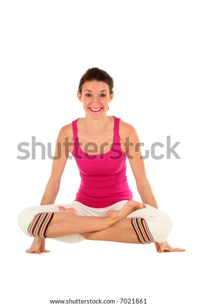 Woman in yoga posture, balancing on her hands