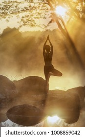 woman yoga practice performance in nature of hot spring source