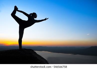 Woman Yoga - relax in nature on the mountain sunset.