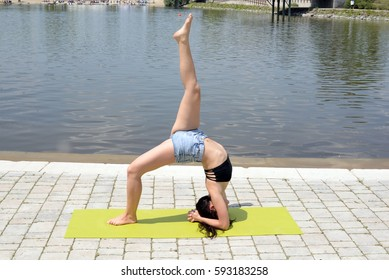 Woman yoga, relax in nature, workout in the park.