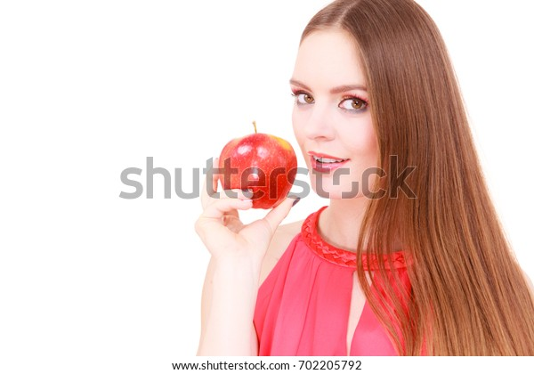 Woman young charming female long haired colorful make up holds big red apple fruit. Healthy eating, vegetarian food, dieting and people concept.