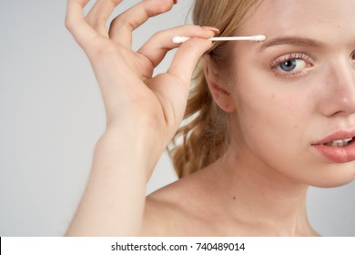 woman young erasing makeup with a wand, clean skin