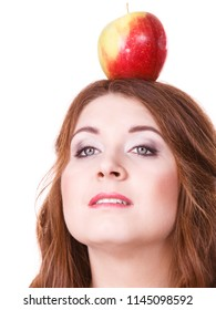Woman young female long hair holding big red green apple fruit on head. Healthy eating, vegetarian food, dieting concept.