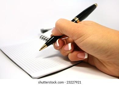 womanish hand writes notebook