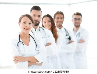 woman-pediatrician on the background of colleagues