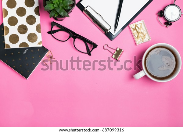 Woman's accessories and cute stationery on pink background, top view