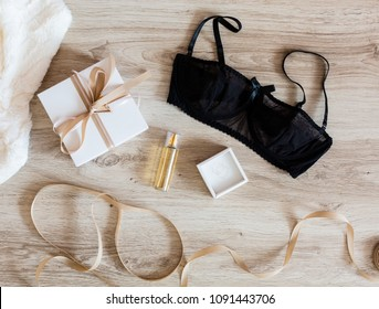 Woman's accessories with a gift box on a wooden background