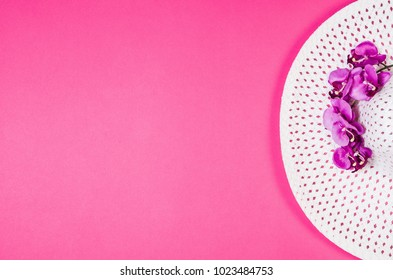 Woman's accessories lying flat on pink paper table background. Pastel colors with copy space around products . Image taken from above, top view. Minimal style with room for text