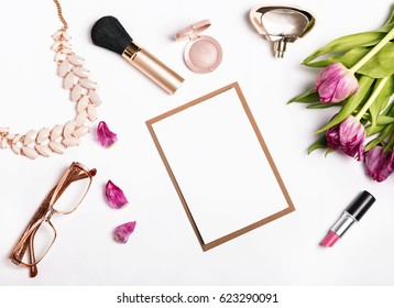 Woman's accessories and pink tulips on white background and paper card mock-up