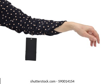 Woman's arm in a sleeve of a new garment with dots and with a hanging sale tag or a price card isolated on white