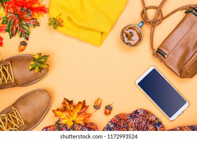 Woman's autumn fashion set, fall accessories on pastel background, Flat lay, top view