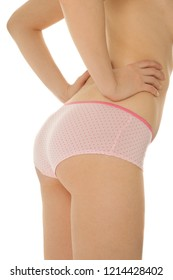 Woman's back and buttocks in pink underwear isolated on white