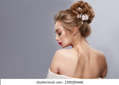woman's back with opened shoulders and perfect flowered hairstyle