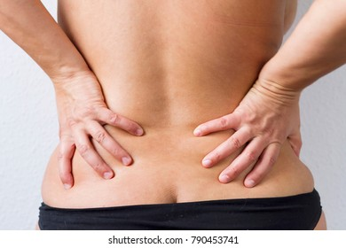 A woman's back with some overweight