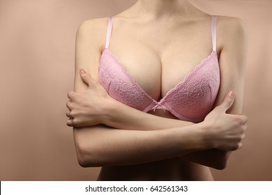 Woman's breast, closeup. Plastic correction and surgery concept