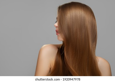 Woman's clean styled hair. Half of the face is covered with brunette hair - Shutterstock ID 1920947978