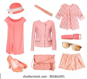 Woman's clothes coral salmon color set.Collage of fashion female clothes & accessories.Summer spring vogue wear isolated on white.