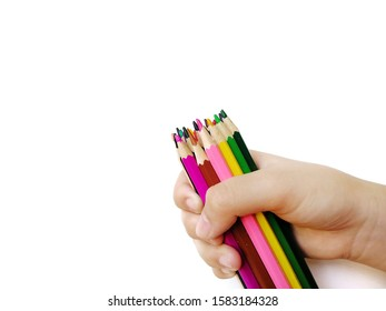 woman's hand holding coloured pencils isolated on white background, selective focus on coloured pencils