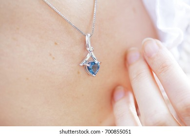 Woman's decollete with a luxury jewelry
