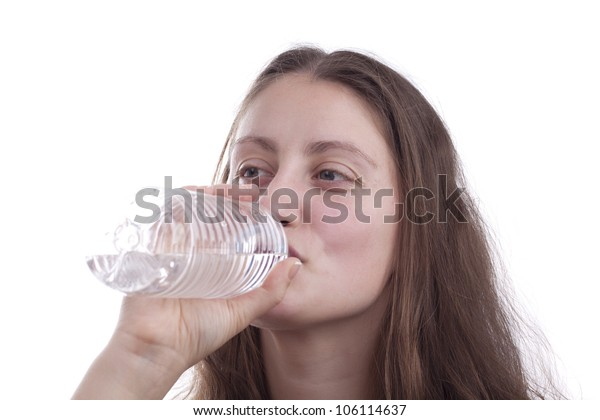 Woman's drinking water from a bottle