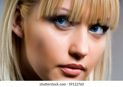 woman's face blonde with beautiful blue eyes