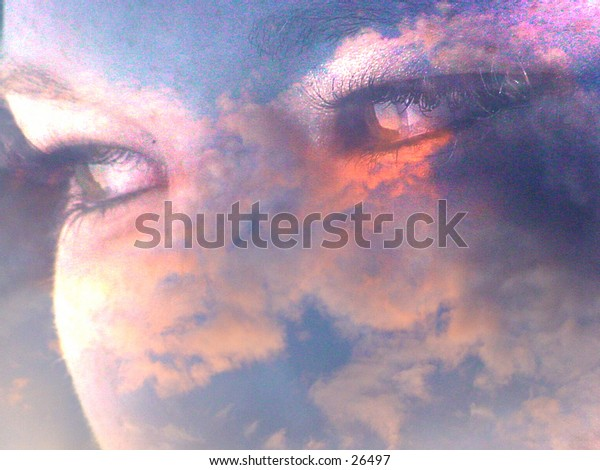 Woman's face in clouds focus on the eyes.