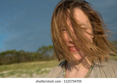 Woman's face is covered with hair