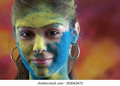 Woman's face covered in holi colours