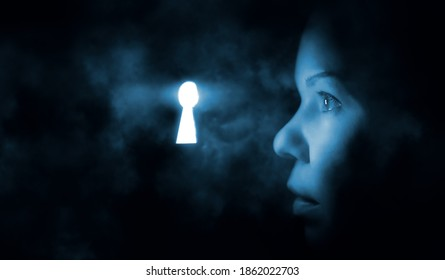 the woman's face in the dark looks through the keyhole glowing blue mysterious light