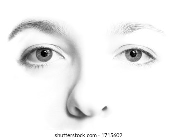 Woman's face in   high key black and white with very detailed eyes.