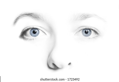 Woman's face in high key black and  white with colorful blue eyes.