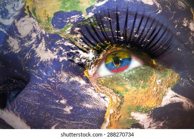 woman's  face with planet Earth texture and ecuadorian flag inside the eye. Elements of this image furnished by NASA.