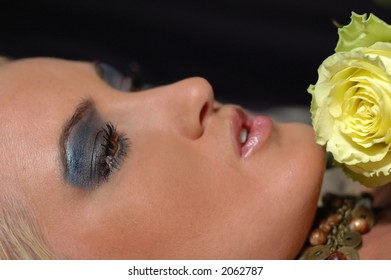 Woman's face with rose