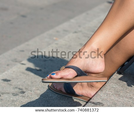 543975d5f Womans Feet Flip Flops Shoes Stands Stock Photo (Edit Now) 740881372 ...