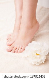 Woman's Feet isolated on white. Pedicure concept. Nails. Spa. Skincare. Depilation. Epilation