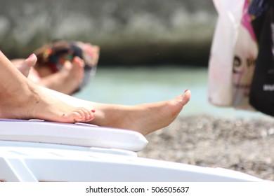 woman's feet  on the beach