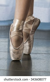 Woman's Feet in Pointe Shoes