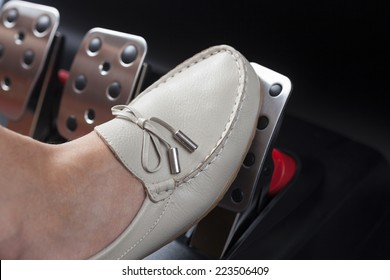 Woman's foot pressing the gas pedal.