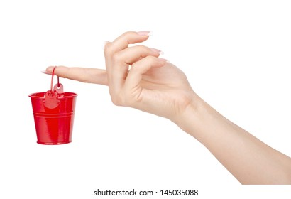 Woman's hand with a bucket on a white background.