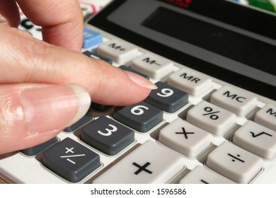 woman's hand calculating on calculator