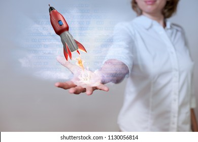 Womans hand with data and red starting rocket.