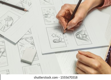 Woman's hand draws a storyboard for a film or cartoon.