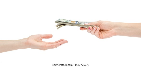 Woman's hand giving money to empty hand. Isolated on white.